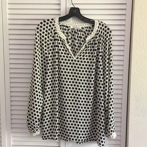 Black and white polka-dotted tunic. Gently used